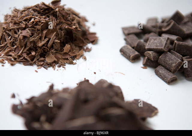Dark and milk chocolate shavings and chunks.  - Stock Image