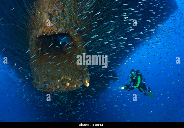 Diver at Anchor Hawse Hole at Bow of USS Saratoga Marshall Islands Bikini Atoll Micronesia Pacific Ocean - Stock Image