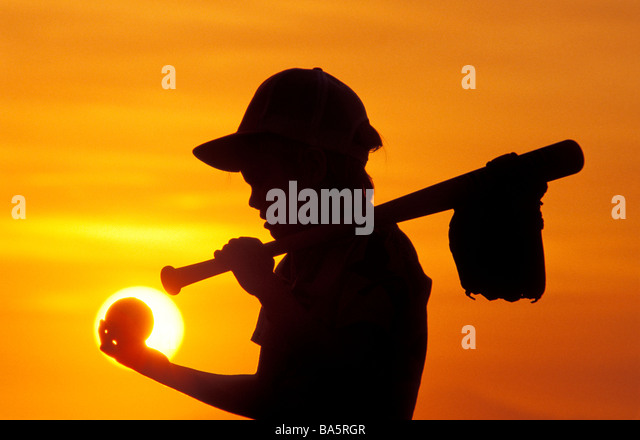 Boy carrying baseball equipment - Stock Image
