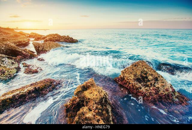 Scenic rocky coastline Cape Milazzo. Sicily, Italy - Stock Image
