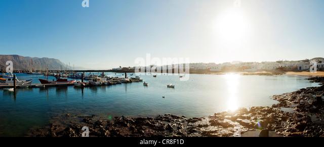 Sunlit harbour in La Gracioca, Lanzarote, Spain - Stock Image