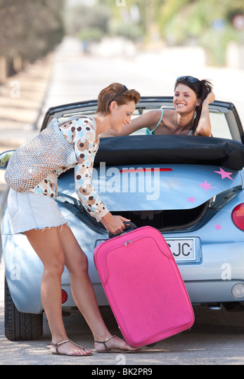 Two women going off on holiday - Stock Image