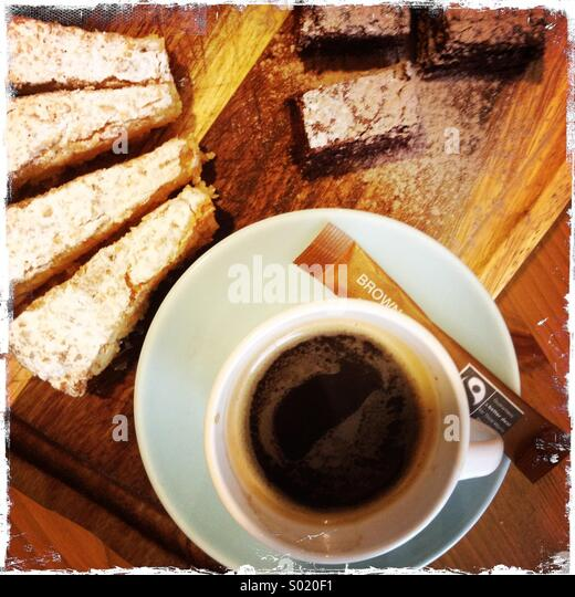 Expresso cup of coffee with cake - Stock Image