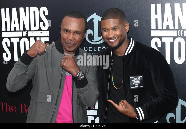 New York, USA. 22nd August, 2016. Sugar Ray Leonard and Usher Raymond IV at the 'HANDS OF STONE' Premiere - Stock-Bilder