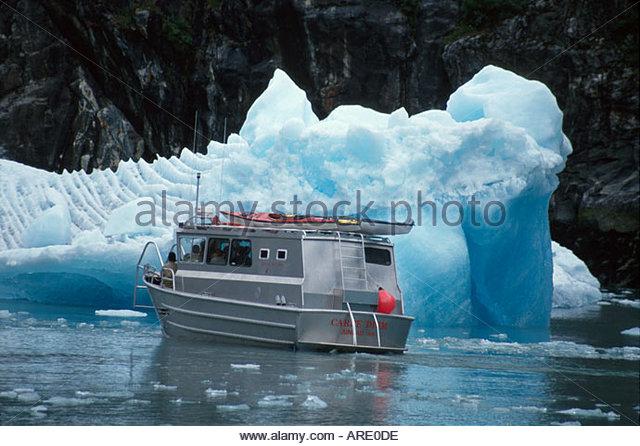 Alaska Juneau South Sawyer Glacier Tracy Arm Fjord Glacier Cruise Carpe Diem tour boat near iceberg - Stock Image