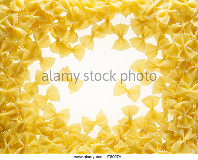 farfalle pasta on a white background - Stock Image