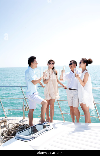 Friends Relaxing on a Yacht - Stock Image