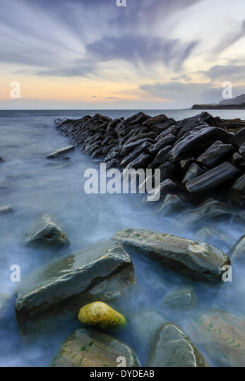 Sunset at Kimmeridge Bay in Dorset. - Stock Image