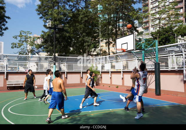 chinese men playing basketball aberdeen hong kong hksar china asia - Stock Image