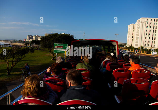 Tourists on the panoramic Sightseeing Red Bus at Sea Point, Cape Town, South Africa - Stock Image
