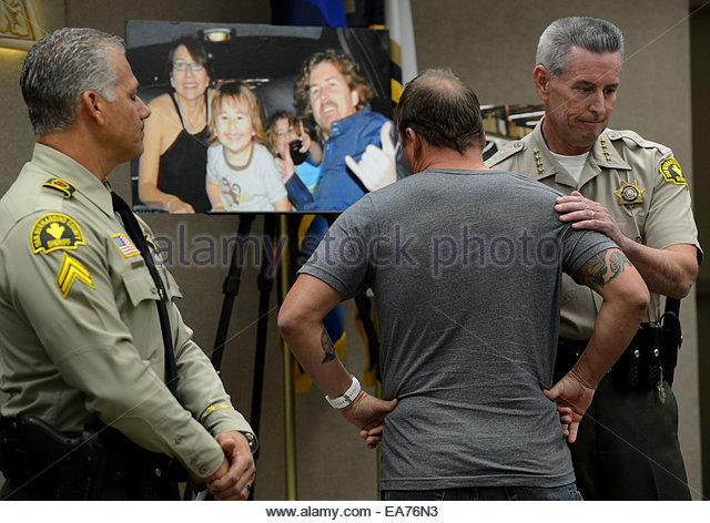 San Bernardino, California, U.S. 7th Nov, 2014. MICHAEL MCSTAY is consoled by Sheriff JOHN MCMAHON as he reacts - Stock Image