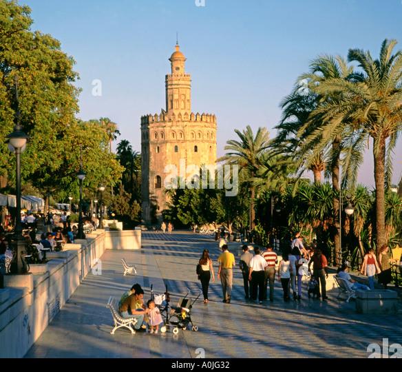 Spain Andalucia Sevilla Torre del Oro promenade people - Stock Image
