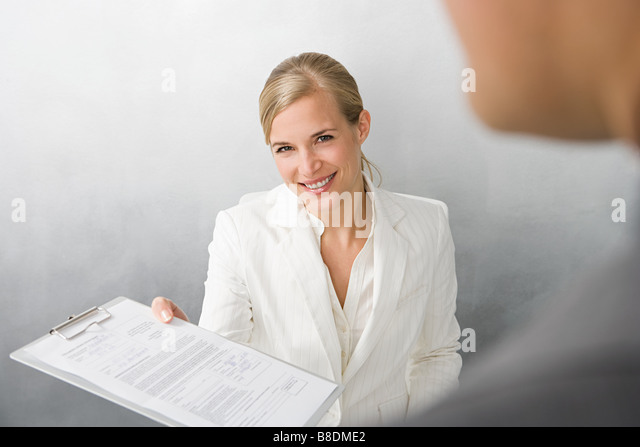 Woman with form on clipboard - Stock Image