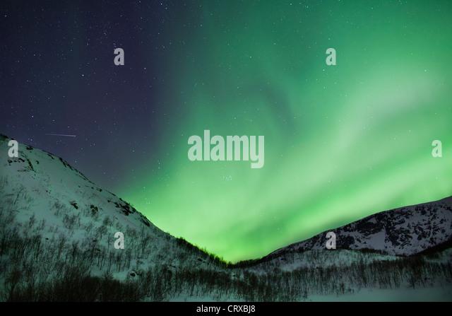 Aurora Borealis The Northern Lights fill the sky at Kvaloya in the Arctic Circle near Tromso, Northern Norway - Stock-Bilder