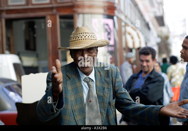 A street performer dances for crowds in the fashionable shopping street of Calle Obispo in Old Havana in Cuba West - Stock Image
