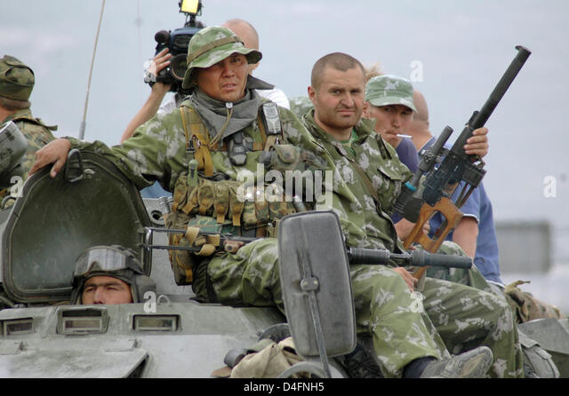 (FILE) - Russian infantry sits on its mechanized combat vehicle near Gori, Georgia, Thursday, 14 August 2008. Russian - Stock Image