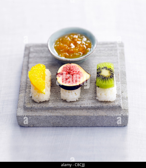 Sushis with colored fruits - Stock Image