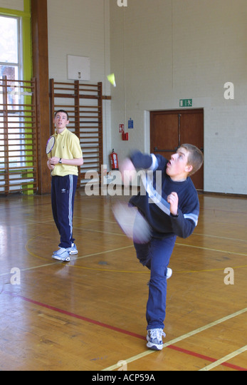Students playing badminton at Sixth form College South London - Stock Image