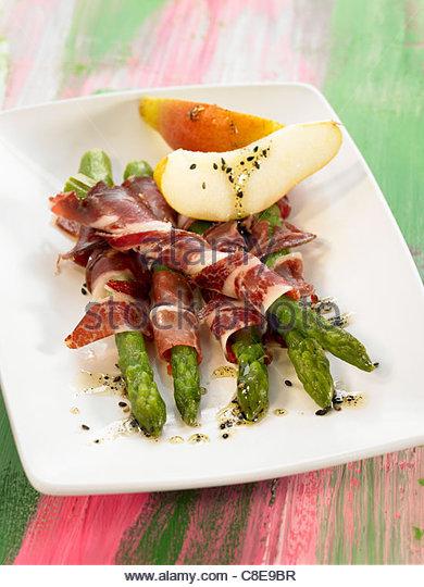 Green asparagus with spanish ham - Stock Image