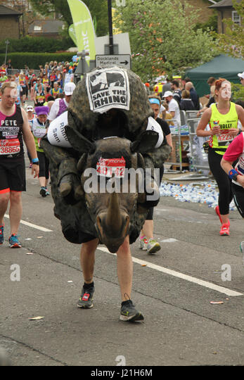 London, UK. 23rd Apr, 2017.  Save The Rhino runner Sam race towards the 17 mile mark at Madchutte during the 37th - Stock Image