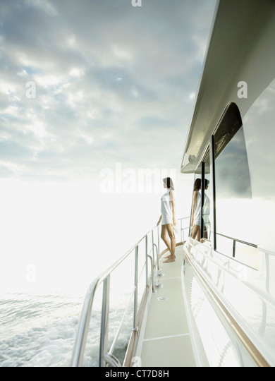 Woman standing on yacht - Stock Image