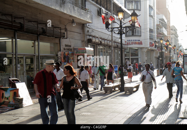 Santo Domingo Dominican Republic Ciudad Colonial Calle el Conde Peatonal Hispanic pedestrian mall street scene man - Stock Image
