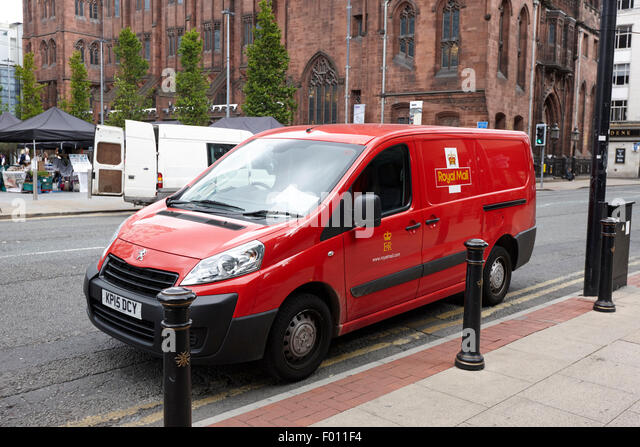 royal mail peugeot delivery van on double yellow lines Manchester city centre England UK - Stock Image