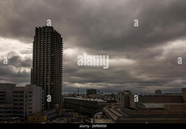 A stormy sky over the Barbican centre with BT Tower in the distance - Stock Image