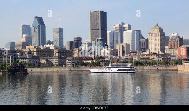 Montreal skyline and cruise boat on Saint Lawrence River - Stock Image