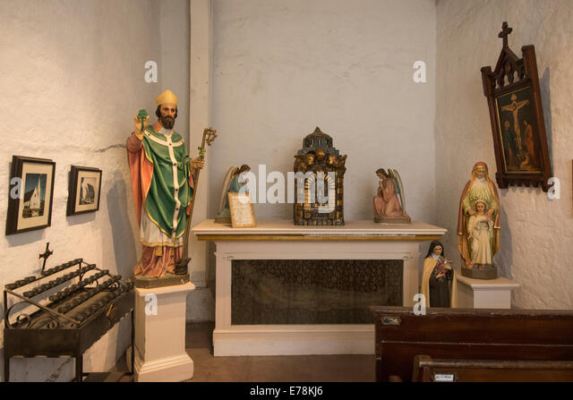 altar and religious statues inside museum of Mission San Jose; San Jose; California USA - Stock Image