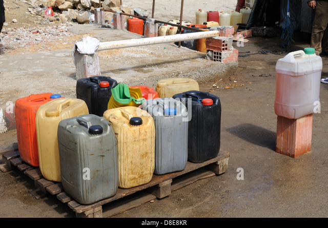 Petrol in plastic drums brought in illegally from Algeria and sold in Ain Draham market Tunisia - Stock Image