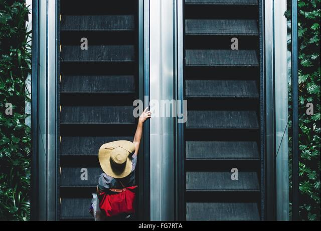 High Angle View Of Person On Escalator - Stock Image