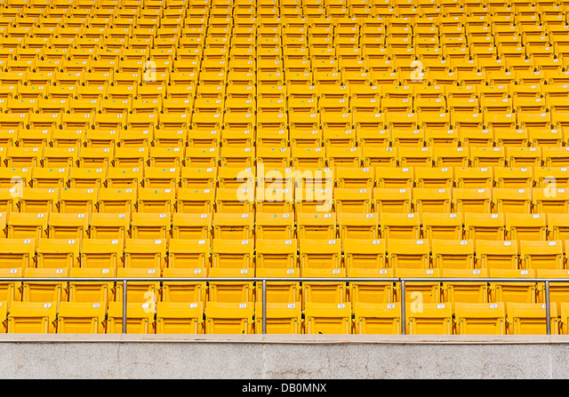 Yellow seats in the stadium prepare for watching and cheer sports - Stock Image