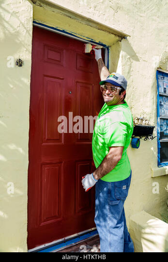 Miami Florida Allapattah Martin Luther King Jr. Day of Service MLK senior home repair Hispanic man corporate volunteer - Stock Image