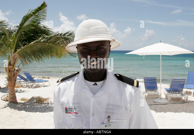 Grand Turk Cockburn Town Cruise Ship Center beach Black male security guard - Stock Image