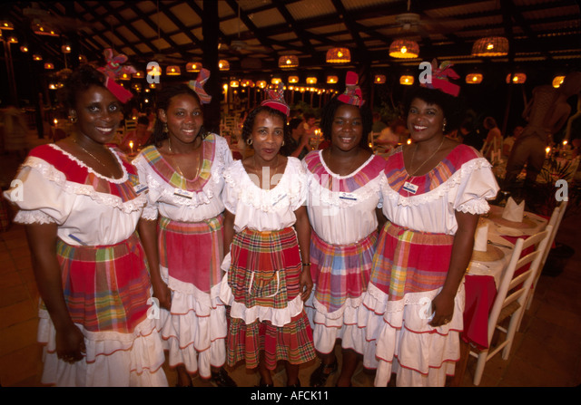 West Indies St. Lucia Anse Chastanet Resort Beach Restaurant Black female waitresses traditional costumes - Stock Image
