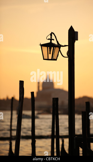 Traditional lamp and The Chiesa del Santissimo Redentore at sunset, Venice, Veneto region, Italy - Stock Image