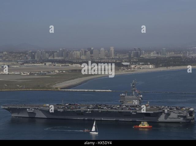 Aircraft carrier USS Ronald Reagan (CVN-76) returns to its homeport in San Diego after spending over a year in Bremerton, - Stock Image