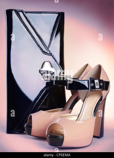 Fashion accessory still life of stylish high heel womens shoes and a clutch handbag - Stock Image