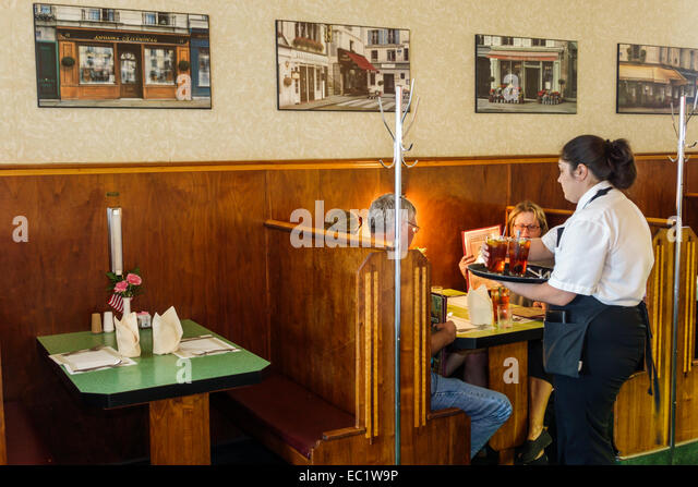 Illinois Litchfield Historic Route 66 The Ariston Cafe restaurant inside interior booth woman waitress employee - Stock Image