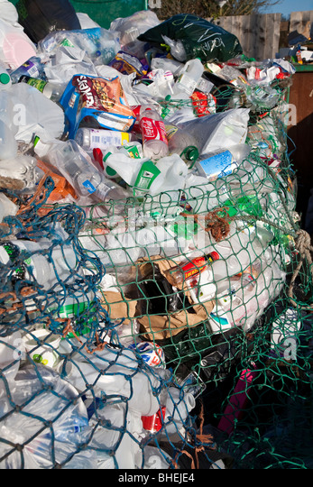 Waste at recycling collection station in car par UK. - Stock Image