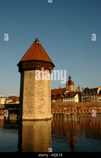 Lucerne Switzerland Chapel Bridge or Kapellbrucke Water Tower Town Hall in Background - Stock Image