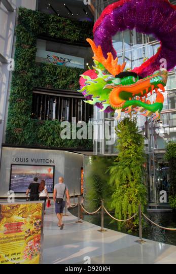 Bangkok Thailand Pathum Wan Rama 1 Road Siam Paragon complex mall shopping Louis Vuitton Chinese New Year dragon - Stock Image