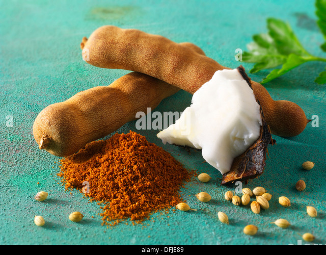 Whole tamarind pods, coconut, ground chilli powder & coriander seeds. Indain spices - Stock Image