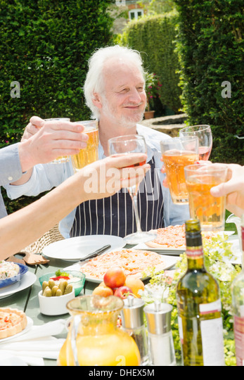Group of people enjoying food and drink outdoors - Stock Image