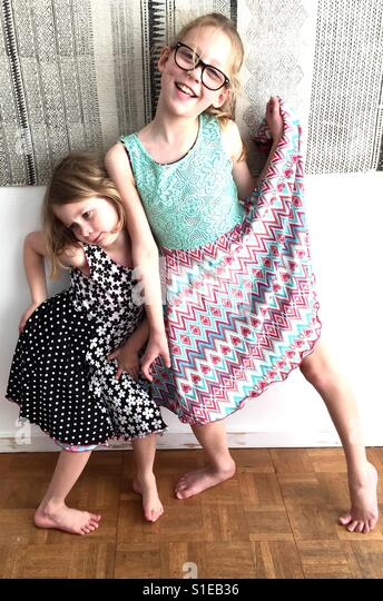Girls showing there new dresses - Stock Image