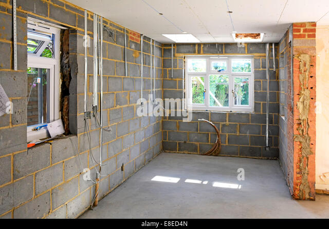 House extension detached house new kitchen area alongside existing structure awaiting plastering Brentwood Essex - Stock Image