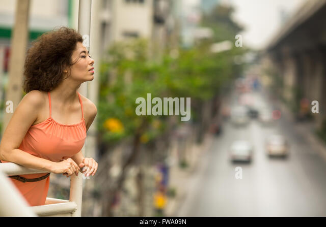 Beautiful Asian woman standing on the overpass. - Stock Image
