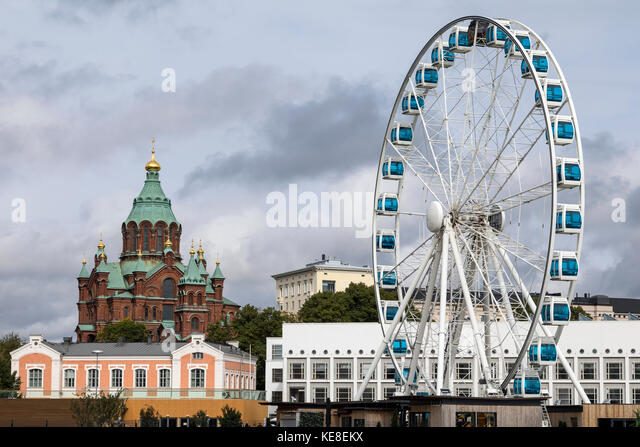 Uspenski Cathedral and the Skywheel in the city of Helsinki in Finland. - Stock Image