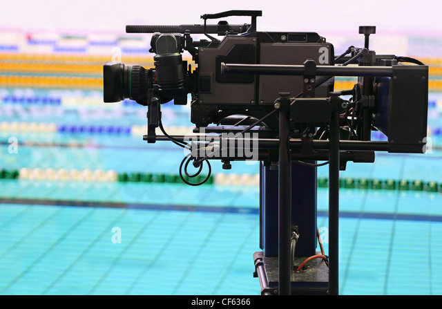 Professional camera for  survey of video in swimming pool in sporting complex - Stock Image